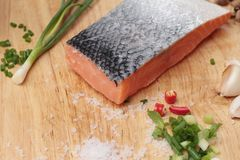 Fresh raw salmon fillet on wood background. Fresh raw salmon fillet on wood background Royalty Free Stock Images