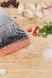 Fresh raw salmon fillet on wood background. Stock Photo