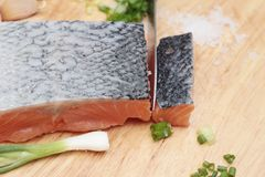 Fresh raw salmon fillet on wood background. Fresh raw salmon fillet on wood background Stock Photography