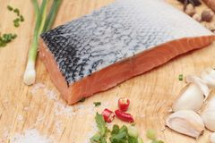 Fresh raw salmon fillet on wood background. Fresh raw salmon fillet on wood background Royalty Free Stock Photography