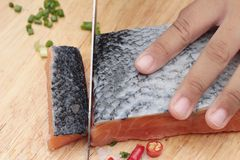 Fresh raw salmon fillet on wood background. Royalty Free Stock Photos