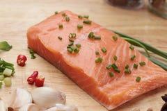 Fresh raw salmon fillet on wood background. Fresh raw salmon fillet on wood background Stock Photos