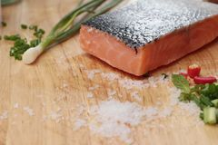 Fresh raw salmon fillet on wood background. Fresh raw salmon fillet on wood background Stock Image