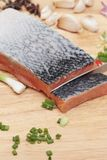 Fresh raw salmon fillet on wood background. Fresh raw salmon fillet on wood background Royalty Free Stock Photo