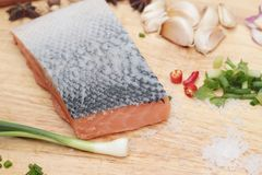 Fresh raw salmon fillet on wood background. Fresh raw salmon fillet on wood background Stock Photo