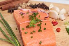 Fresh raw salmon fillet on wood background. Fresh raw salmon fillet on wood background Royalty Free Stock Photo