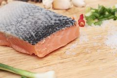 Fresh raw salmon fillet on wood background. Fresh raw salmon fillet on wood background Stock Images