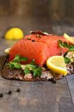 Fresh raw salmon fillet. Fresh raw salmon fillet on a wooden background Stock Photography