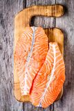 Fresh raw salmon fillet on a wooden cutting board Royalty Free Stock Photography