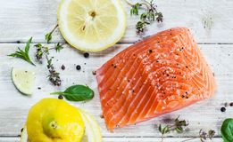 Salmon Fillet On A Table. Fresh raw salmon fillet on wooden rustic table - top view. Healthy food, diet or cooking concept Royalty Free Stock Image