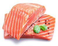 Fresh raw salmon fillets decorated with green basil royalty free stock image