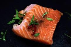 Fresh raw salmon fish on black background. Recipe concept and design menu royalty free stock photo