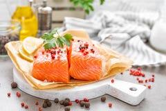Fresh raw salmon fish fillet on white kitchen background. Closeup stock photography