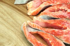 Fresh Raw Salmon Fish Steaks On Wood Cutting Board. Close-up Stock Images