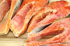 Fresh Raw Salmon Fish Steaks On Wood Cutting Board. Close-up Royalty Free Stock Images