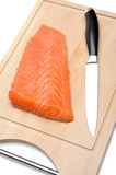 Fresh raw salmon fish on wooden board. Isolated. sushi ingredient Royalty Free Stock Photography