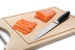 Fresh raw salmon fish on wooden board isolated. Sushi ingredient Stock Photos
