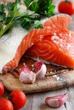 Fresh raw salmon. On a wooden cutting board Royalty Free Stock Photo