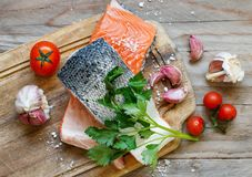 Fresh raw salmon. On a wooden cutting board Stock Images