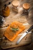 Fresh raw salmon. Fresh raw salmon on wooden cutting board Royalty Free Stock Images