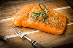 Fresh raw salmon. Fresh raw salmon on wooden cutting board Stock Photography