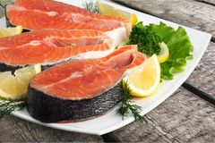 Fresh raw salmon with salt and lemon on. Fresh raw salmon green red closeup market Royalty Free Stock Photography