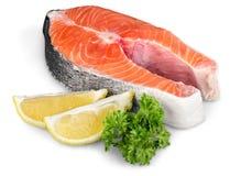Fresh raw salmon with salt and lemon on white. Fresh raw salmon green red closeup market Royalty Free Stock Photography