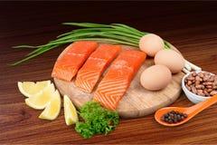 Fresh raw salmon with salt and lemon on wooden. Fresh raw salmon green red closeup market Stock Image