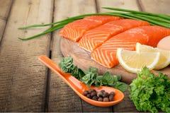 Fresh raw salmon with salt and lemon on wooden. Fresh raw salmon green red closeup market Stock Photos
