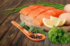 Fresh raw salmon with salt and lemon on wooden. Fresh raw salmon green red closeup market Stock Photography