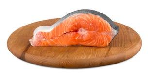 Fresh raw salmon with salt and lemon on wooden. Fresh raw salmon green red closeup market Royalty Free Stock Photos
