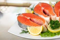 Fresh raw salmon on white plate. Fresh raw salmon green red closeup market Stock Photos