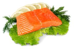 Fresh raw salmon with salt and lemon on. Fresh raw salmon green red closeup market Royalty Free Stock Image