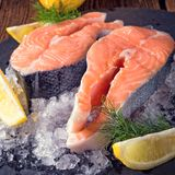 Fresh raw salmon on ice. A fresh raw salmon on ice Stock Photo