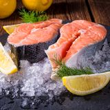 Fresh raw salmon on ice. A fresh raw salmon on ice Royalty Free Stock Photos