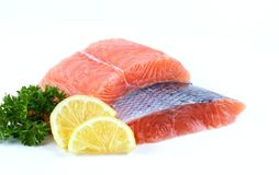 Fresh raw salmon. Fresh salmon with lemon and parsley Royalty Free Stock Photography