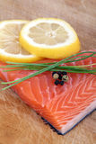 Fresh raw salmon. With lemon and pepper royalty free stock photography