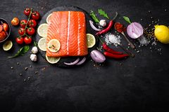 Fresh raw salmon red fish fillet on black background. Top view Royalty Free Stock Image