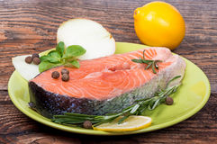 Fresh raw salmon red fish steak with herbs, spices. And vegetables Royalty Free Stock Images