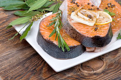 Fresh raw salmon red fish steak with herbs, spices. And vegetables Stock Photo