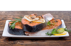 Fresh raw salmon red fish steak with herbs, spices. And vegetables Stock Image