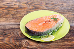 Fresh raw salmon red fish steak with herbs, spices Stock Image