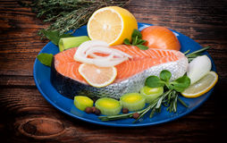 Fresh raw salmon red fish steak with herbs, spices. And vegetables Stock Images