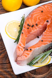 Fresh raw salmon red fish steak with herbs and vegetables Royalty Free Stock Photos