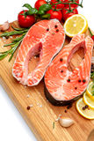 Fresh Raw Salmon Red Fish Steak. Isolated on cutting board Stock Photo