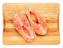Fresh Raw Salmon Red Fish Steak. Isolated on cutting board Royalty Free Stock Photography