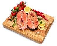 Fresh Raw Salmon Red Fish Steak. Isolated on cutting board Stock Images