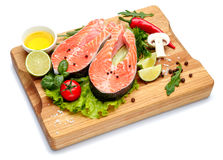 Fresh Raw Salmon Red Fish Steak. Isolated on cutting board Royalty Free Stock Images