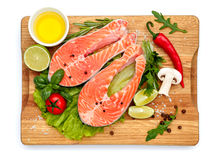 Fresh Raw Salmon Red Fish Steak. Isolated on cutting board Royalty Free Stock Photos