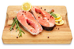 Fresh Raw Salmon Red Fish Steak. Isolated on cutting board Royalty Free Stock Image